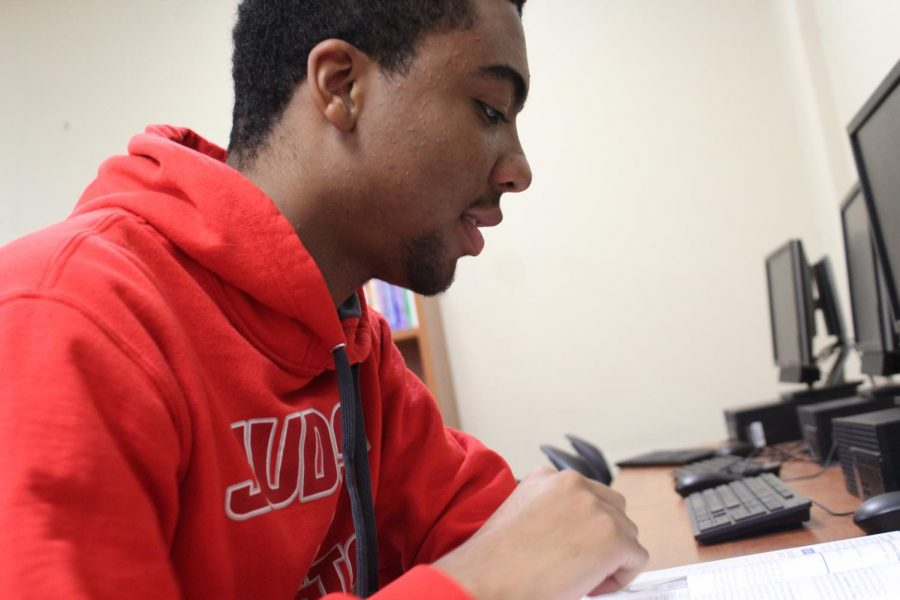 Cameron White works on his computer science work. White hopes to go to college and major in computer science.
