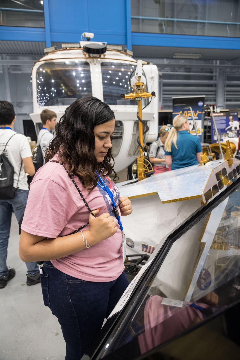 Senior Melanie Villarreal looks through a display case at NASA's Johnson Space Center in Houston. She is leading efforts on campus to get others to participate in the program next year.