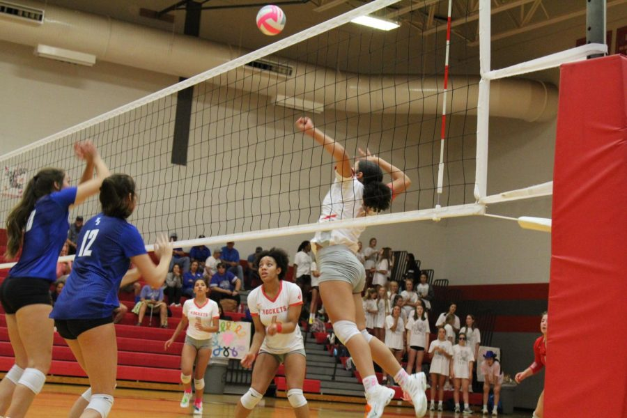 Junior Tatyana Gladden spikes the ball againsts New Braunfels during their annual Pink Out game.