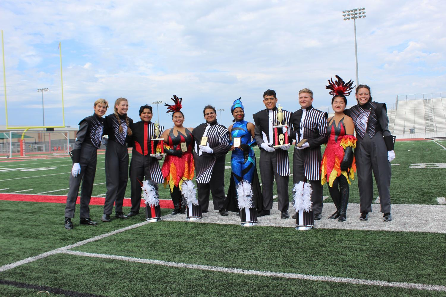Band leaders gather to display their awards at the Comal Classic Marching Festival.