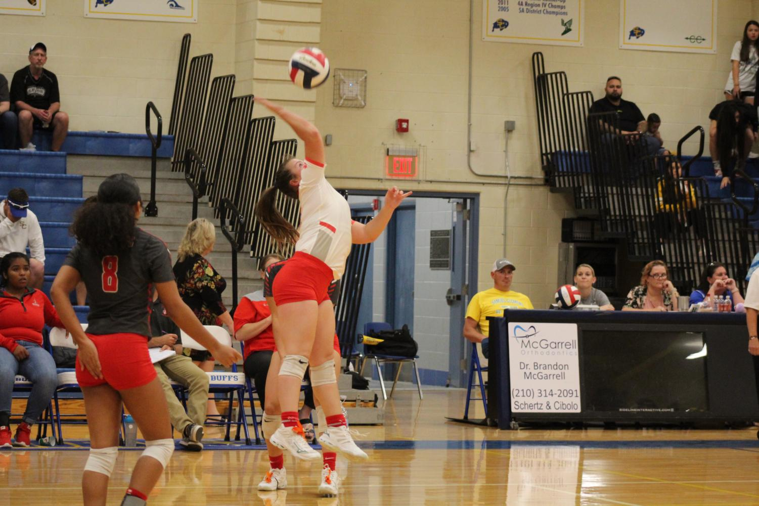 Sophomore Madelyn Thorton serves the ball to begin the next play againsts Clemens. She is the libero for the team. The Rockets fell to the Buffalos in three sets.