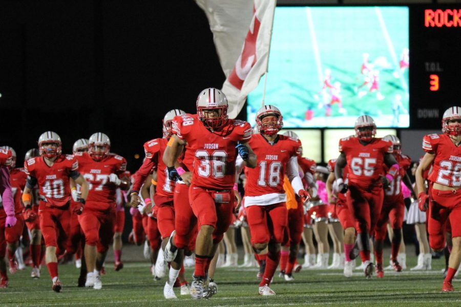 The+Rockets+run+onto+the+field+at+D.W.+Rutledge+Stadium+for+their+Pink+Out+game+against+Smithson+Valley.+The+Rockets+beat+the+Rangers+30-13.+Clemens+is+the+next+highly+anticipated+game+in+the+district.