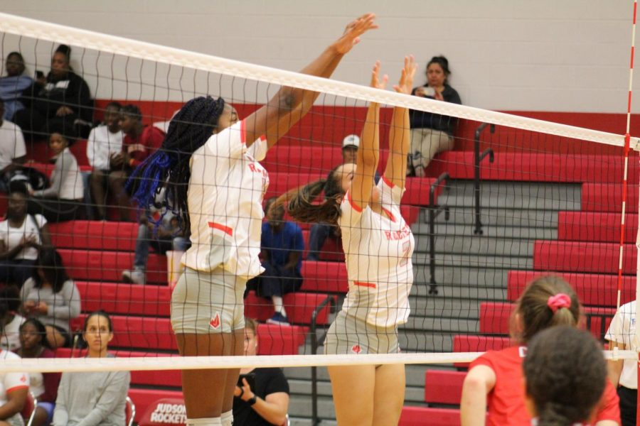 Freshmen Olivia Rubio and sophomore Jada Leal jump up for a block againsts New Braunfels Canyon.