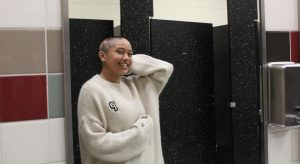 Sophomore Victoria Villaflor receives support from swim team after shaving her head due to Alopecia