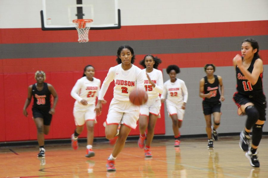 Senior Teanna Huggin dribbles the ball up the court in the game against Stevens. She is a returning starter from last years state championship team.