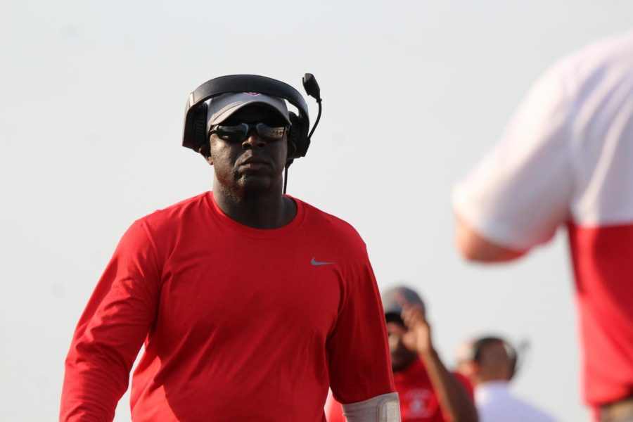Coach Rodney Williams walks on the sidelines during the first regular season game against the Clear Springs Chargers. This is his first year has head coach.