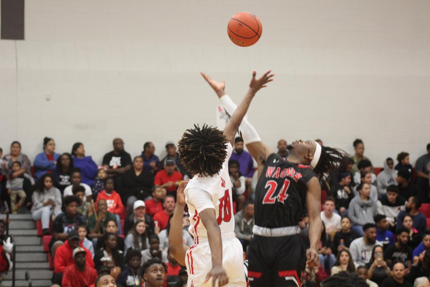 Senior Ja'Kolby Cornelius and Wagner's Journee Philips tip off at the first boys basketball game of the season. The Rockets fell to the Thunderbirds, 57-75.