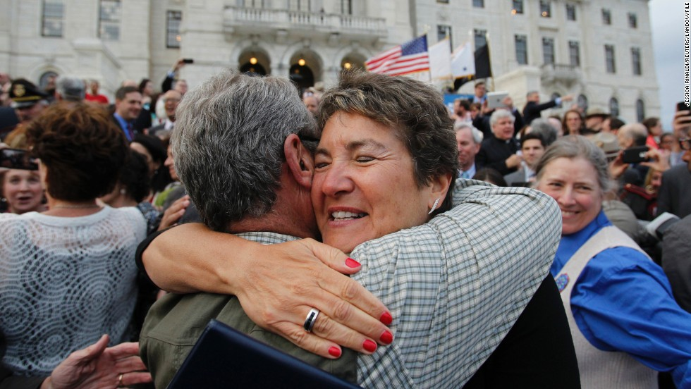 Image #: 22200211    Senator Donna Nesselbush (R) embraces a supporter after the Marriage Equality Act was signed into law at the State House in Providence, Rhode Island, May 2, 2013. Rhode Island became the 10th U.S. state to extend marriage rights to same-sex couples. REUTERS/Jessica Rinaldi (UNITED STATES - Tags: POLITICS SOCIETY)       REUTERS /JESSICA RINALDI /LANDOV
