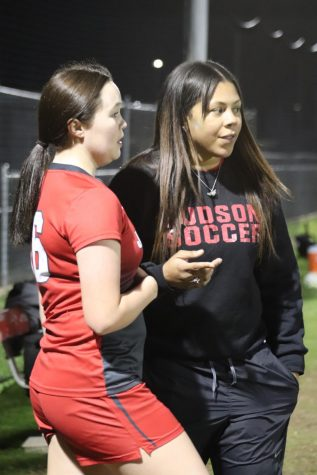 Coach Mukley coaches sophomore Leilani Kato during their game on January 24, 2019.