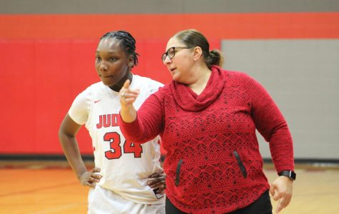 Coach Triva Corales coaches senior Jonmecia Baskin, a key player on the team.