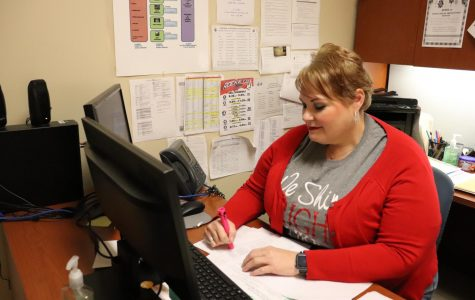 Counselor Leslie McClellan works on student's schedules for the next school year. She has been a counselor on campus for seven years.
