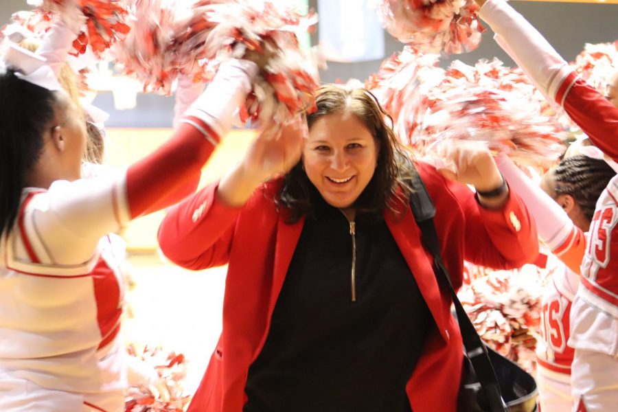 Coach Corrales celebrates through a spirit tunnel made by the Judson Cheerleaders. This is the fourth consecutive regional tournament for Corrales and girls basketball.