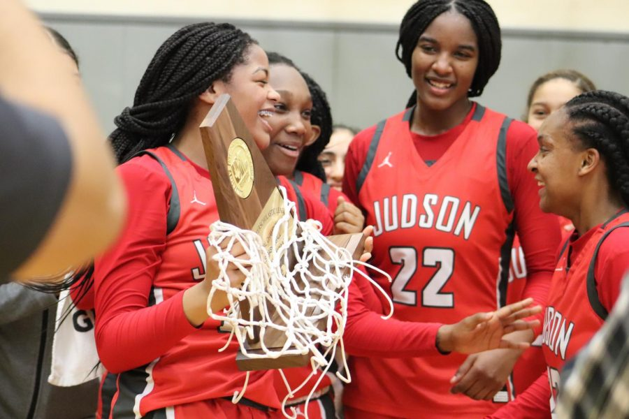 The+girls+celebrate+their+regional+championship+after+beating+Westlake%2C+50-47.+This+is+Judson%27s+fourth+consecutive+appearance+at+the+state+tournament.