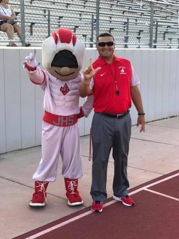 Coach John Torres takes a picture with Rocket Man during a game at Rutledge Stadium. Torres retired from Judson ISD and education in 2019.