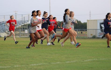 The girls cross country team takes off during their scrimmage run with the team from Veterans Memorial. This was a friendly race between the two as they start their season.