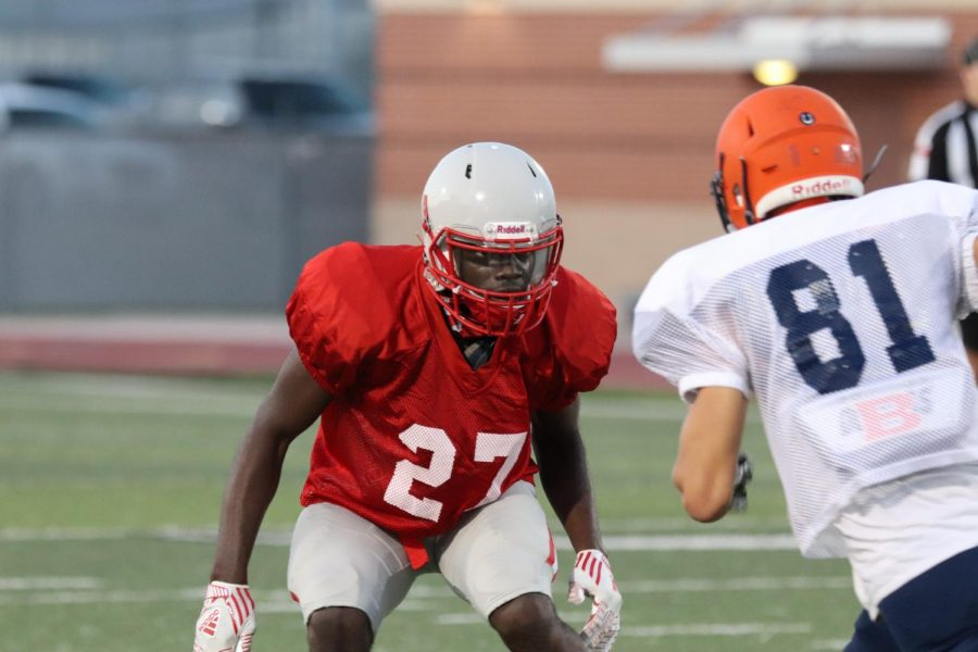 Senior Ifeanyi Okoli guards a wide receiver during the scrimmage against Brandeis. The Rockets will play against DeSoto to open the season.