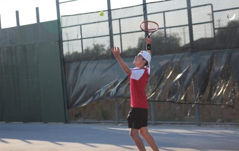 Junior Diego Cortes serves the ball during a match against East Central. The Rockets fell to the Hornets 10-4.