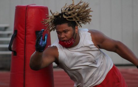Senior Nathaniel Pryor ducks and weaves during a dummy drill at a morning football practice. The football first scrimmage against Brandis on September 25, 2020.