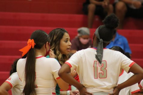 Coach Kimberly De Los Santos coaches her girls during the game against Clemens. The girls fell to Clemens, 0-3.