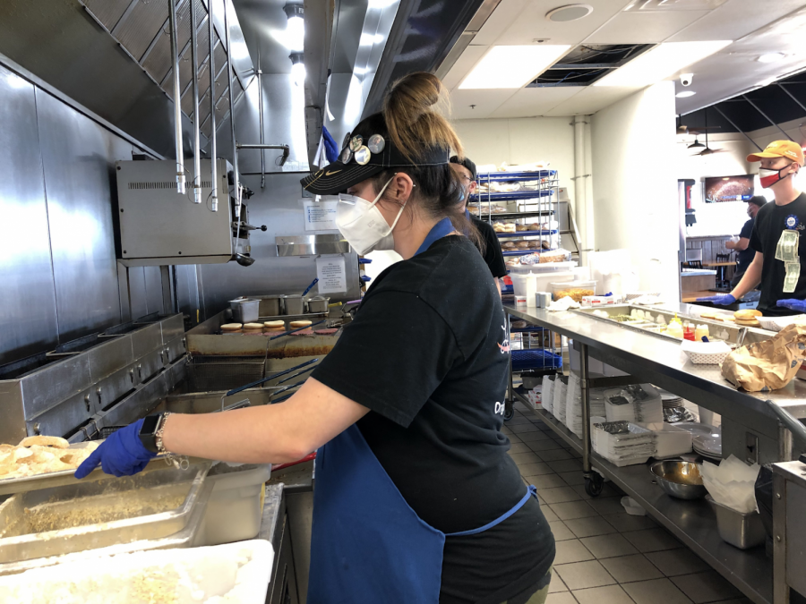 As people were coming in for their afternoon lunch, Lois Glenn is seen making onion rings for customers to enjoy. She is the manager of The Longhorn Cafe, an area restaurant that has been greatly impacted by COVID-19.