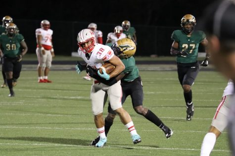 Senior Kameron Lopez fights off a Desoto defender after a catch. The Rockets fell to Desoto 37-0.