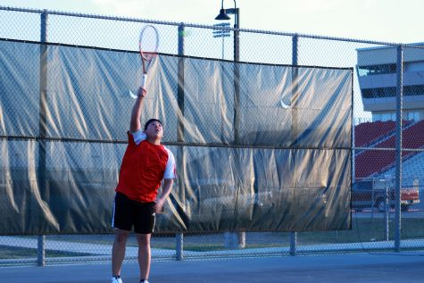 Senior Dylan Juarez serves the ball during his match against the Knights. The Rockets lost to the Knights, 10-1.