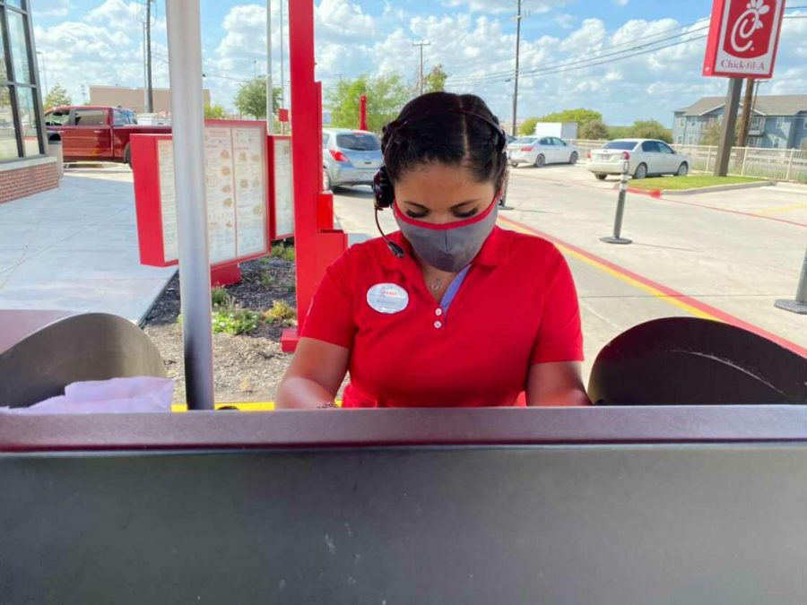 Senior Montse Reyes works the cashier line at ChickFilA on FM78. Her plan is to graduate in December.