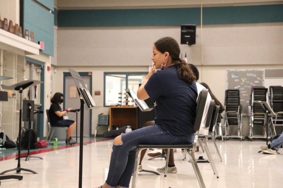 Freshman Shairalis Rivera Guzman plays the flute during her band class. Many freshmen like her didn't expect their first year of high school to be so different.