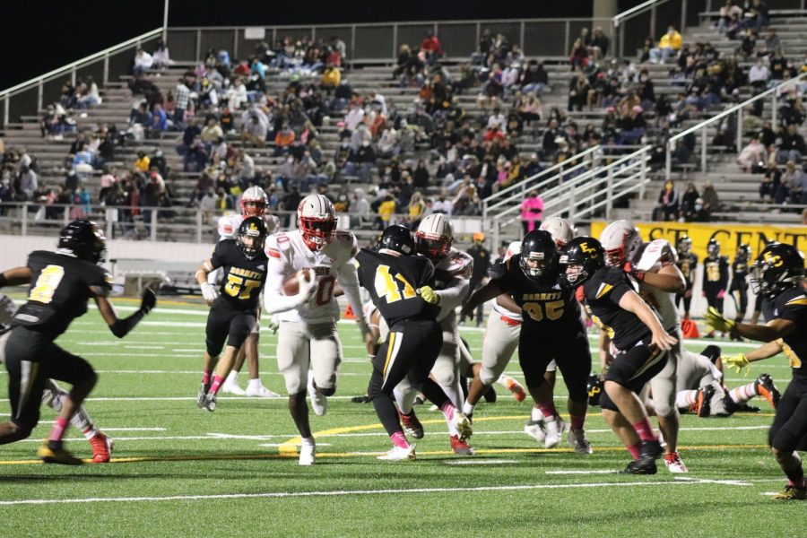 Senior De'Anthony Lewis runs through a group of Hornet defenders during the football game on Friday, Oct 30, 2020. The Rockets beat East Central 48-13.