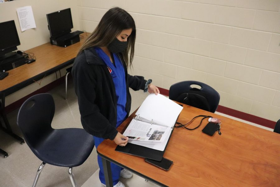 Senior Kristalyn Bermudez looks over pages that have been finished for this year's yearbook. She will lead the production of this year's yearbook.