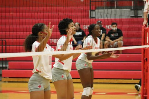 Juniors Cirila Pettit, Alania Afalava, and Alexis Walker set up and wait to block the ball from Steele. The Lady Rockets fell to the Knights, 0-3.