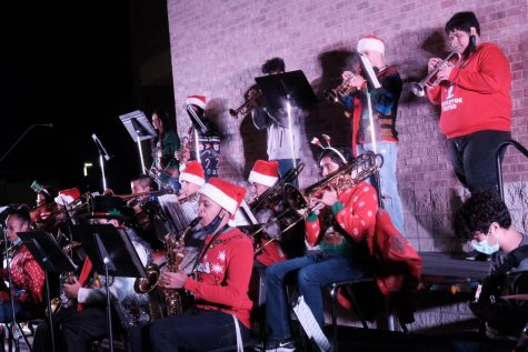 "The band performs at the first ever ""Holiday in the Park-ing Lot."" This was an outdoor concert fine arts put on because of COVID-19 restrictions."