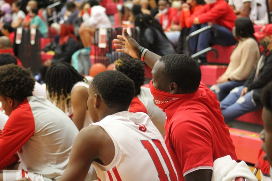 Coach Shawn Bedford coaches XXXX during the game against Wagner.