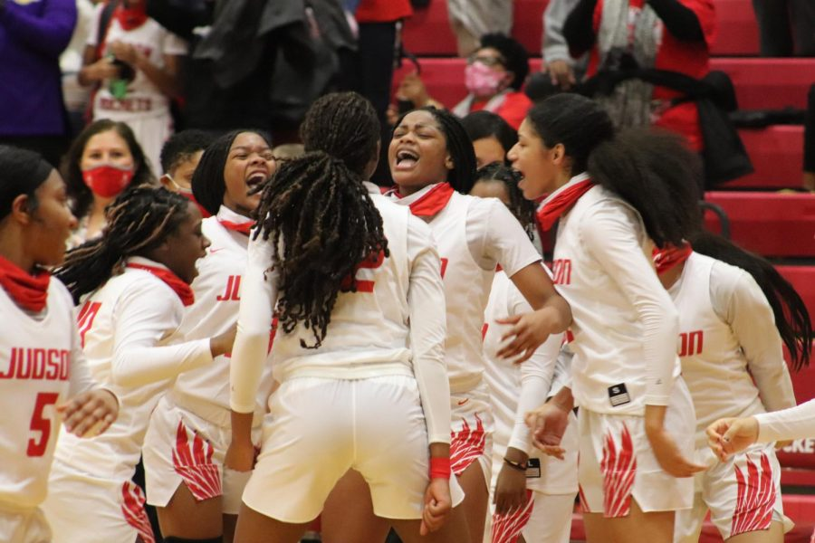The girls celebrate a big win against Reagan, 48-39. Junior Amira Mabry scored big with 20 points for the night.