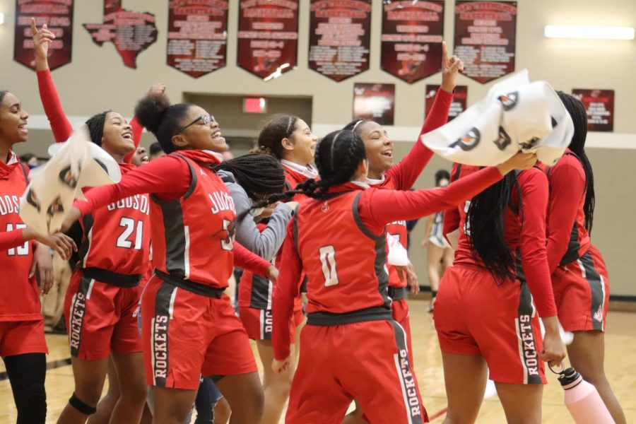 The girls basketball celebrates their first win of the playoffs after they beat Johnson. At press time, the next round opponent has yet to be determined.