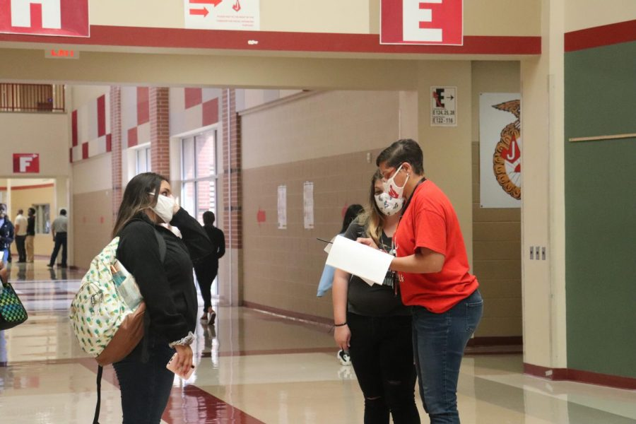 Ms. Carter helps students to class in the first wave of students returning to campus. On March 29, a new group - who have struggled with the online environment, will return to campus.