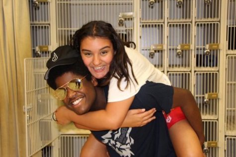 Junior Jon James and Christina Moriel, graduate of 2020, hang out in the band hall after a marchathon.