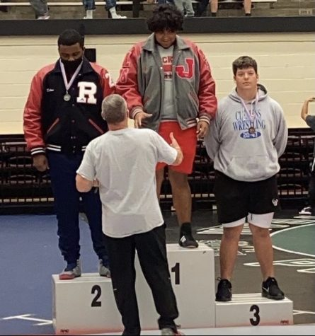 On Saturday, April 10, Coach Guenther congratulates junior Jahire Campos as he earns his district title at the Blossom Athletics Center.