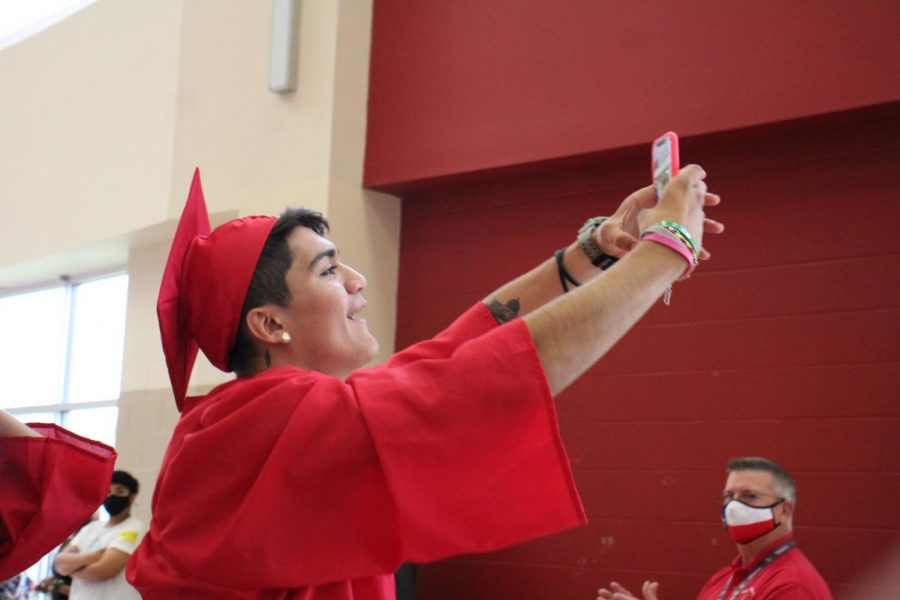 Senior+Johnatan+Zavala+takes+a+selfie+with+him+and+his+friends+during+the+annual+Elephant+Walk.+The+class+of+2021+will+graduate+on+Saturday.