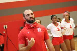 Coach Andrew Fields coaches the team during the first home game against Warren.