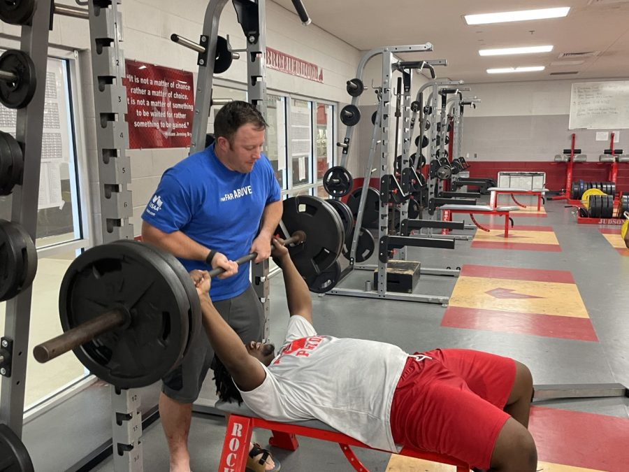 Coach+Randle+helps+senior+Josiah+Walker+with+his+bench+press+during+a+meeting+on+Saturday%2C+August+28.+Currently%2C+Randle+is+looking+for+more+students+to+join+the+team.