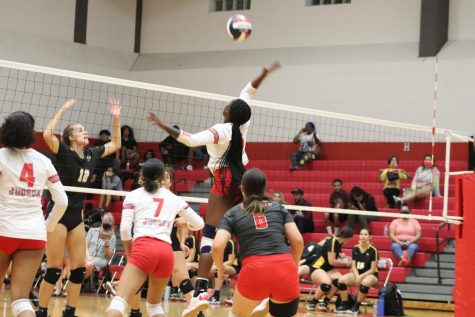 Senior Alexis Walker goes for the kill during their game against East Central. The ladies ended up falling to the Hornets, 3-1.