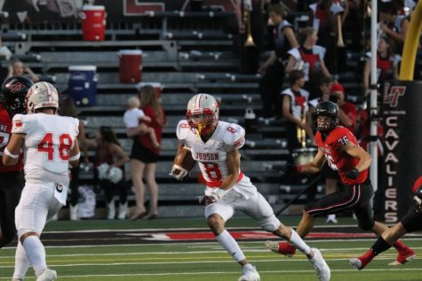 Senior Andre Jones receives the ball after the kick off from Lake Travis. The Rockets fell to the Cavaliers, 52-20.