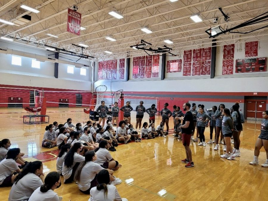 Coach Andrew Fields talks to both varsity volleyball players and Woodlake Middle School players. The goal of the clinic is to create a pipeline and prepare middle school athletes for high school sports.