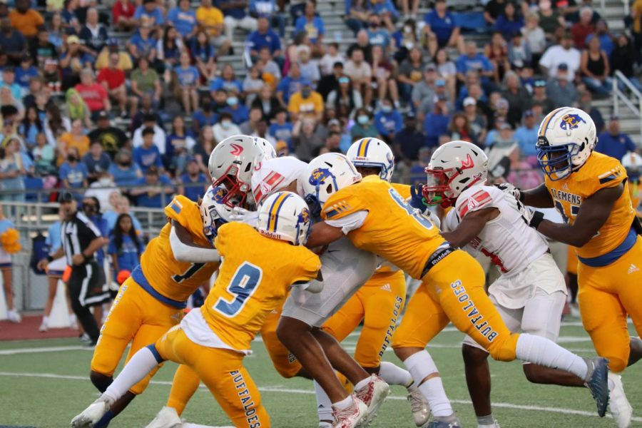 Junior Gavin Harris pushes through the Clemens defense, in an attempt to score. Football ended up falling to Clemens, 17-14.