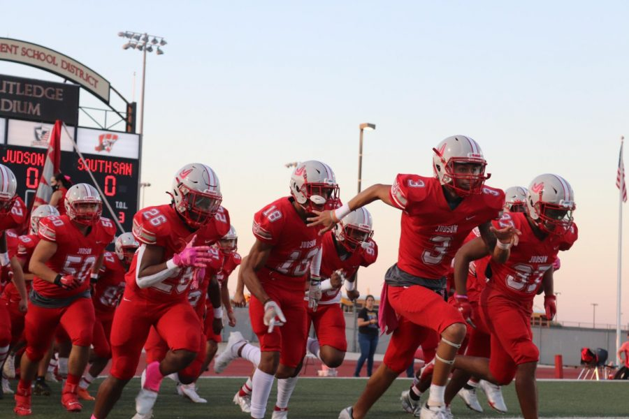 The football team runs out on the field to prepare for their game against South San. They beat the Bobcats, 37-0.