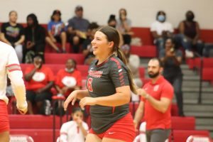 Senior Madalynne Thornton cheers on her team during her game against Steele. She holds the title of captain of the team and libero.