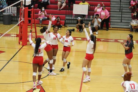 The Lady Rockets celebrate their win against Wagner in the annual Dig Pink game.
